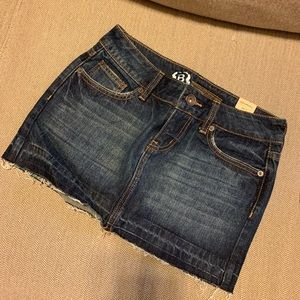 Dark wash raw edge mini denim jean skirt